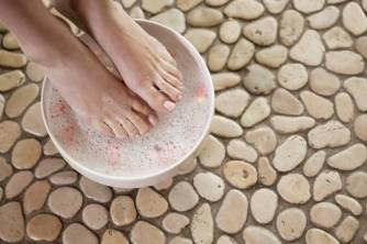 Woman soaking her feet in bowl